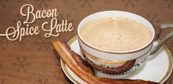 cup and saucer containing bacon spice latte and a strip of cooked bacon